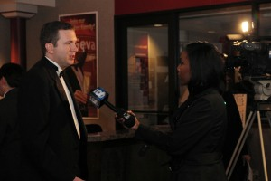 Executive Director Tom Parrish speaks to a reporter