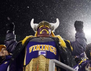 A fan cheers for the Minnesota Vikings, the team Walter (Amid Purpleheart) used to play for. (AP Photo)