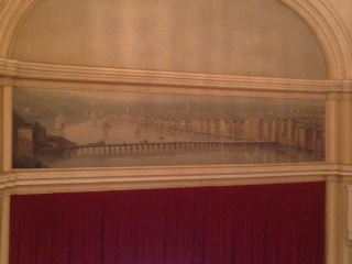 The mural above the stage